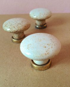 3 old speckled ceramic drawer pulls.