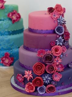 Flamboyant, fun and totally Bright colours are perfectly complimented with handmade  stylised  roses and fantasy  flowers.