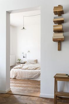 It doesn't get more perfect than this! Stunning wooden floors and industrial lamp in the bedroom. Wow. xx