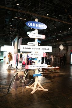 Road signs at the entrance not only established the theme of a road trip, but also gave guests directions to the various stations set up inside Cedar Lake for Old Navy's spring 2015 preview.  Photo: Courtesy of Old Navy