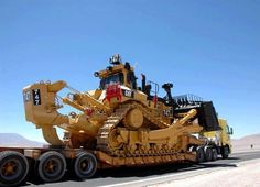 CAR shiny new going to a job site on a triaxle COE Volvo tractor and triaxle RGN trailer. Caterpillar Bulldozer, Caterpillar Equipment, Cat Bulldozer, Heavy Construction Equipment, Heavy Equipment, Construction Machines, Earth Moving Equipment, Crawler Crane, Cat Machines