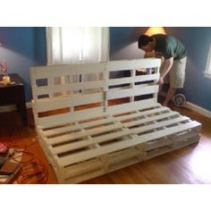 Pallet couch frame - very similar to a futon sofa/bed I used to have.  Place a coloured matress on this and it will look great.