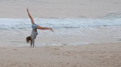 Gisele Bundchen prances on the beach and does cartwheels in Rio after taking part of the Summer Olympics Opening Ceremony