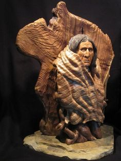 By Charles Milliser. Evening Watch is sculpted from a single piece of Basswood and colored with dilute oil paints and wood stains. The background for Evening Watch is a weathered slab of Russian Olive tree stump.