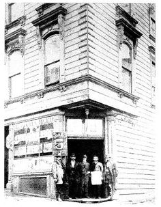 """The Saloon"" ca. 1870, with the elder F. E. Wagner (owner) in the center. The Saloon, located at 1232 Grant Ave in North Beach, is currently the oldest saloon in S.F. and for decades has offered dancing and live music. The Saloon first opened in 1861, and has been in continuous operation ever since. Owned by Ferdinand E. Wagner from Stundwiller, Elsass / Alsace. The Saloon's original name was ""Wagner's Beer Hall"". In 1836 Wagner immigrated to Louisiana and moved on to S.F. in 1852."