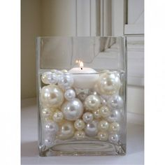 Make a wedding colored pearl bead centerpiece. Except with flowers, now candles