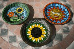 Sun Flower Power! This unique and one of a kind mosaic wall hanging will fit right in your garden space. it is bright and cheery, and will