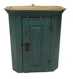 """Blue-painted hanging pine cupboard   19th century   Molded cornice above raised panel door opening to three shelves and three small drawers.... 27.5 h x 24 w x 11 3/4"""" d"""