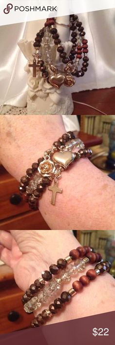 Cross Heart Rose Brown & Gold Bracelet Cross Heart Rose Brown & Gold Bracelet.  In a new condition use them maybe one or twice. Comes from a non-smoking home I ship within 24 hours Monday through Friday. If you have any questions please all! Jewelry Bracelets