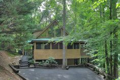 Cabin 4056, tucked in the woods close to our fishing ponds. Hidden Mountain Resorts