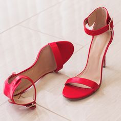 Ladylike and elegant! These Giovanna Heels in red scream just that, and so much more. Features an open-toe style with single strap, ankle strap with side buckle closure. Heel cup. Cushioned heel, rubb