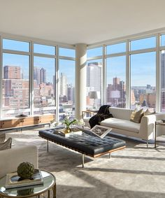 This home features exquisite floor-to-ceiling windows offering breathtaking views of the East River—take a look around! Pictured above, living room. Apartment View, New York City Apartment, Upper East Side, Living Room White, Living Room Windows, Laminate Hardwood Flooring, Office With A View, New York Office, Office Floor