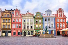 17. The market square bordered by neat rows of colourful buildings in Poznań, Poland, offers visitors a perfect photo opportunity.