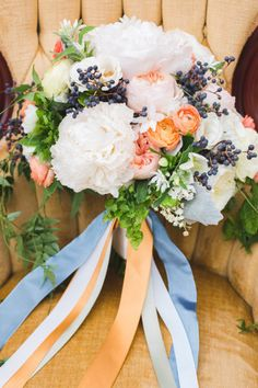 mixed ribbons on bouquet. peach and blue wedding colors.