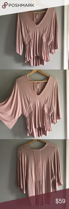 • Free People Blouse • Drapey blouse from Free People. Beautiful blush color and very soft fabric. Elastic accents give it a pleated look. Brand new, without tags Free People Tops Blouses