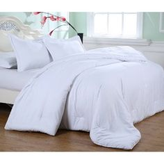 Add comfort and luxury to your bedroom or guest room with this Embossed Microfiber Plush Comforter Set featuring a subtle embossed Greek Key pattern and generous filling. Made from luxury microfiber, your comforter will look great for years to come.