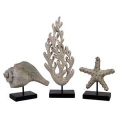 """Set of 3 ocean-themed statuettes on black bases. Product: 3-Piece statuette set  Construction Material: Polyresin and metal     Color: Silver and black    Features: Ocean-themed silhouetteDimensions: Starfish: 8.75"""" H x 7.25"""" W x 3.75"""" D    Conch:  9.5"""" H x 8"""" W x 3.75"""" D    Coral: 18.25"""" H x 11"""" W x 5.25"""" D"""