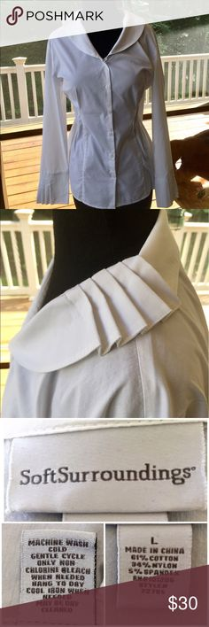 """Soft Surroundings White Pleated Button Down Shirt Beautiful and Unique!  This is a White Button Down V Neck shirt SIZE LARGE.  This is a crisp white shirt with unique pleating around the collar and the cuffs. This shirt is 61% Cotton 34% Nylon 5% Spandex.  It measures 23"""" armpit to armpit and 25"""" down center back.  The sleeves measure 23.5"""" from shoulder seam to lower edge of cuff.  Machine Wash, No issues, SMOKE FREE HOME. Check my other listings. I love to BUNDLE! Soft Surroundings Tops…"""