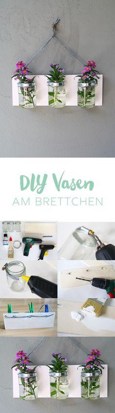 Kreative DIY Idee zum Selbermachen: Vasentrio am Brett mit Schlauchschellen zum Aufhängen