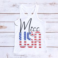 Miss USA | Toddler Tank Top Sparkle in patriotic style for the Fourth of July! Made of lightweight cotton-poly sheer jersey fabric. This makes a great piece for layering. The longer length and racer back detail combined with a splash of sparkle makes this a stylish tank for your little girl.