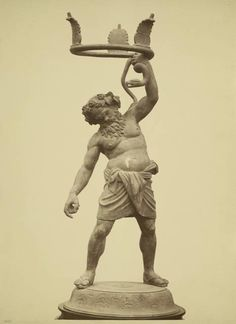 Bronze statue of Drunken Silenus, intended as a stand for a vase, of which the fragments were found nearby.