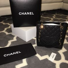 Chanel Petite Shopper Black caviar Gold hardware Authentic Chanel petite shopper with Black caviar leather and gold hardware...this bag is in perfect condition only worn a few times....please ask any questions u have and if u would like to see more pics please ask  CHANEL Bags Shoulder Bags