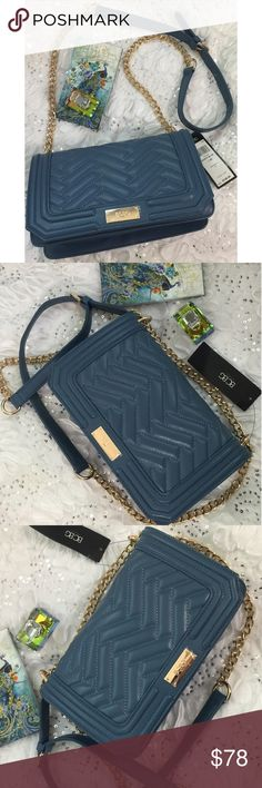 BCBG Paris Dusty Blue Calabasas Shoulder Bag😻😻 A versatile, polished addition to everyday ensembles, this chic bag features a quilted exterior and gleaming hardware for a touch of posh style. Its ample interior and bevy of pockets provide plenty of room to organize your essentials.  11'' W x 7.5'' H x 3.75'' D 17.5'' shoulder drop Man-made Lined Magnetic snap closure Interior: one zip pocket and two slip pockets BCBGeneration Bags Shoulder Bags