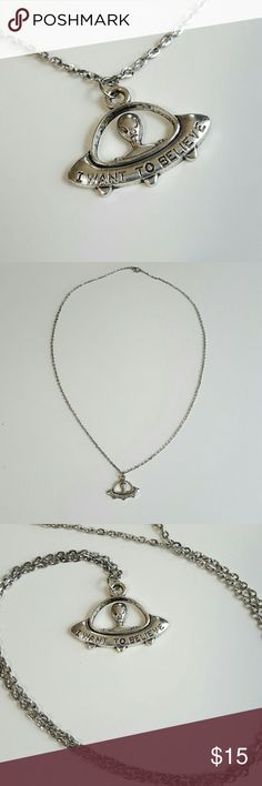 """UFO Alien """"I Want To Believe"""" Necklace Amazing silver toned alien space craft UFO necklace. This necklace has a rocket space craft from out of this galaxy. The alien is not of this world and sits above the words """" I want to believe"""". The chain is 24"""" long. This is great with your favorite shirt and jeans. Charm is 3cm long and 2cm wide. Jewelry Necklaces"""