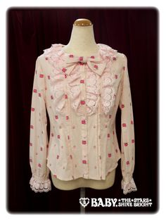 Baby the Stars Shine Bright Secret Garden blouse.  I love lace and frills.