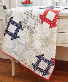 Nothing beats a good old-fashioned Churn Dash quilt block! This one is a bit different, with each quilt block connecting with the ones surrounding it. It's a great throw quilt that you'll enjoy using and displaying in your home.