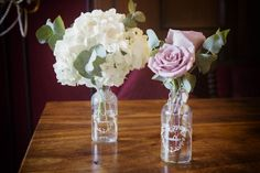 Less is more....glass bottles with flowers to adorn your register book table...