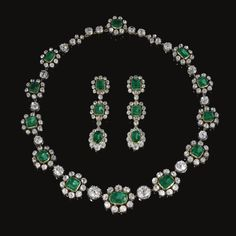 PROPERTY OF A MEMBER OF THE THURN UND TAXIS FAMILY - Very fine emerald and diamond necklace and a pair of earrings, late 19th century The necklace designed as a series of step-cut emeralds bordered with circular-cut and cushion-shaped diamonds, alternating with cushion-shaped stones mounted in cut-down collets, length approximately 475mm, together with a pair of pendent earrings en suite, later clip and post fittings, fitted case by Rath, Munich.