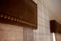leather cornices with nail head trim
