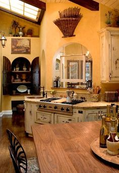 old world kitchen. If this was in an old world Tuscan villa, I'd have to sell my arms and legs so I could move in right now.