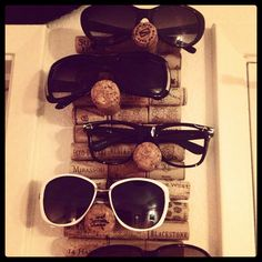 Wine cork sunglasses display..  I need this by Saturday.. Get drinking!!!