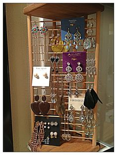 Mail rack turned vertical into earring display case