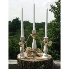 Check out this item in my Etsy shop https://www.etsy.com/listing/239676432/rustic-wedding-unity-candle-holders