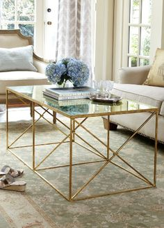 This table is good for small spaces because of its glass and metal design. The table takes up little visual space, but actually provides a large amount of tabletop.