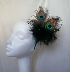 Black Peacock Feather Fluff feather Crystal Fascinator Victoriana Headband, Order Now from www.indigodaisyweddings.co.uk Specialising in stunning bespoke cocktail fascinators and formal hats in a wide range of colours, perfect for Royal Ascot and The Kentucky Derby.