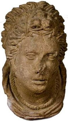 Early 3rd century B.C. Trachyte  This piece, from Orvieto, was carved from a hard, dark-gray volcanic stone called trachyte. It must have adorned the front of a monumental tomb or a public monument; similar elements are on the front of Perugia's Porta Marzia. The woman has an intense expression; her carefully arranged hair is kept in place by ribbons and metal pins. She is wearing a torque and pyramid-shaped earrings.  3rd BC from  Orvieto