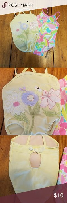Two One Piece Suimsuits, 6-12 months, Gymboree Two adorable one piece swimsuits, both size 6-12 months. Yellow one is made by Old Navy. The top front have a stains on the top. Gently used condition, lots of life let! The pink blue green one is made by Gymboree.  Excellent Used Condition! Gymboree Swim One Piece