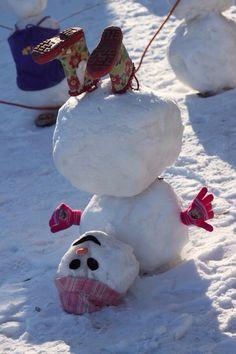 Funny snowman! Winter snow Christmas snowman drunk upside down