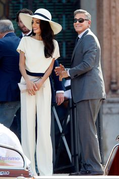 Amal Alamuddin (looking gorgeous in 1970s inspired Stella McCartney) and George Clooney, Venice civil ceremony.