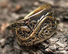 This is a real solid bronze 3-dimentional hand-crafted antique finish adjustable size ring. The ring features the Helm of Awe or Aegishjalmur in the middle with the Futhark alphabet around it and two Mjolnirs on the sides.  Aegishjalmur, or the Helm of Awe, is an Icelandic magical symbol of protection, also called stave, which has the power to induce fear and to protect against abuse of power. Early Vikings used to inscribe it on the forehead between the eyes. Aegishjalmurs main purpose was…