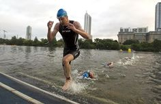 Hunter Kemper emerges from the water of Lady Bird Lake and heads to the bike transition area during the Captial of Triathlon on Monday morning. Photo by Rodolfo Gonzalez/AMERICAN-STATESMAN. Click through for story.