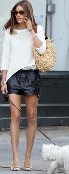 black leather shorts and asymmetrical sweater