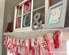 Valentine's Day Heart Cards Garland ~ from Mom's Crafty Space. Everything about this mantel is adorable: the old window with the LOVE letters in the glass could be vinyl, the card garland......so cute.