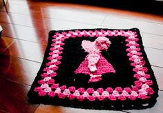 Sunbonnet Sue:  Granny square crocheted motif.  Sorry guys, no pattern here-not sure where to find it but my grandma gave me hers.  This is a link to my variation on the border and some pattern notes for anyone that has the pattern...
