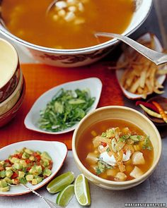 Chicken-Tortilla Soup | Martha Stewart Living - In this tortilla soup, chicken and broth are simmered with cilantro for Southwestern flair. The hot soup is topped with strips of toasted tortillas, sour cream, and guacamole.