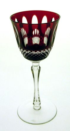 Unique wine glasses in different colors. Multilayered crystal glasses ...